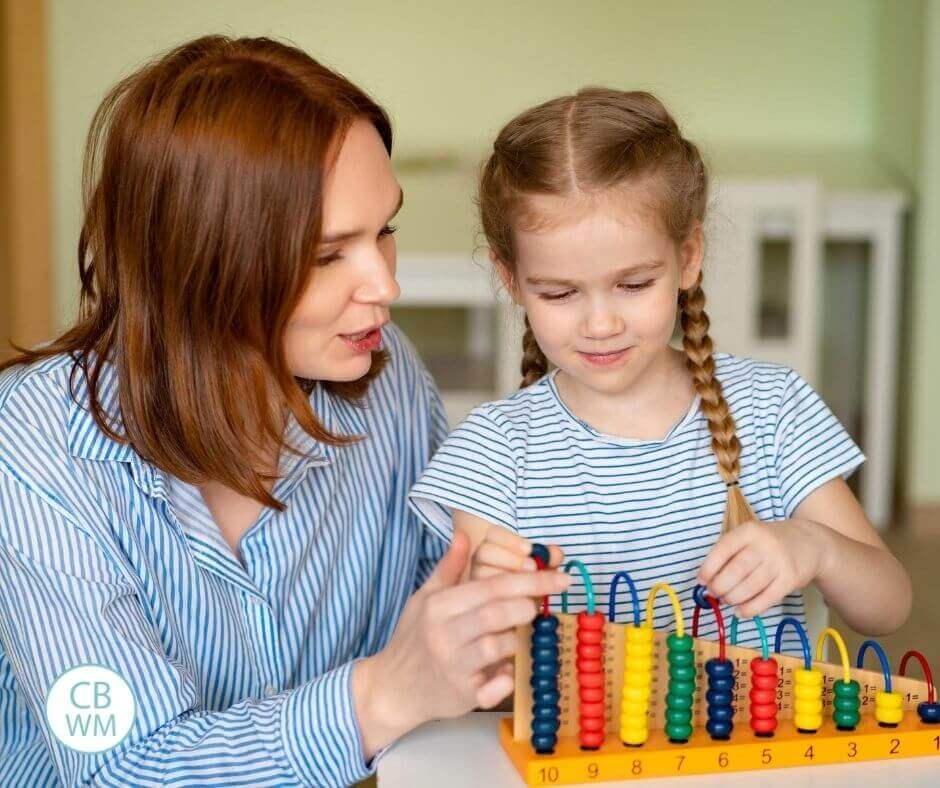 Mom and daughter doing preschool at home