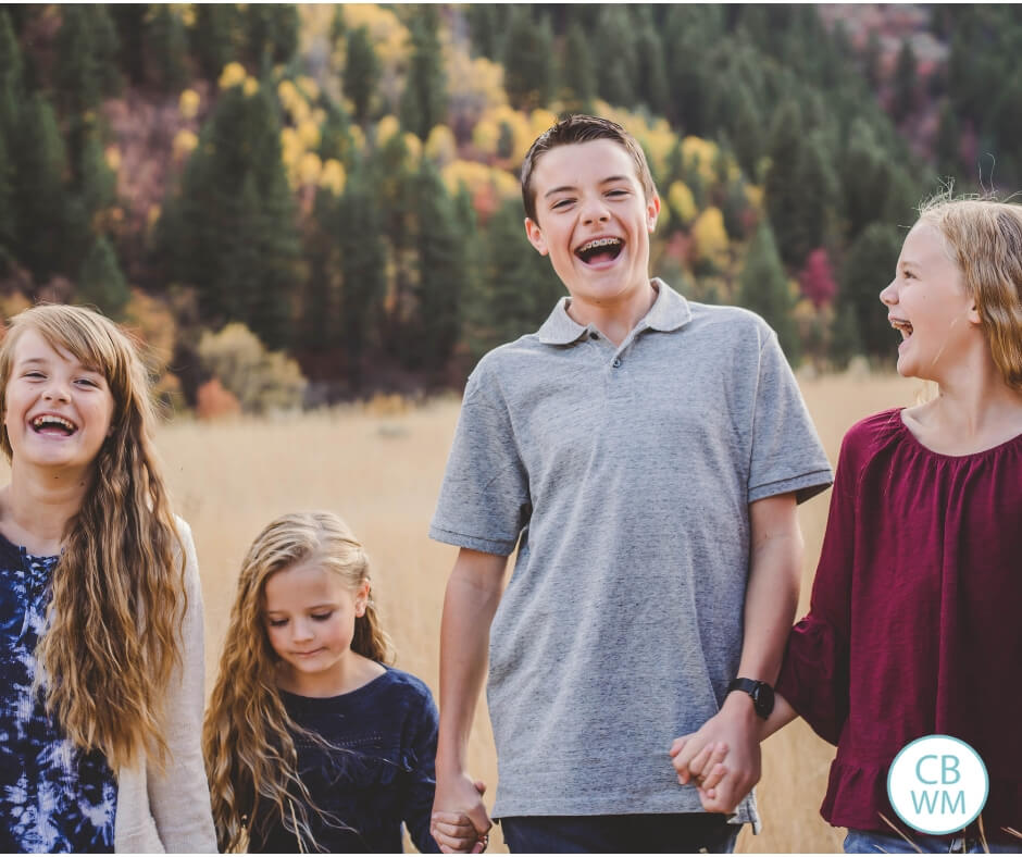 Group of siblings laughing together