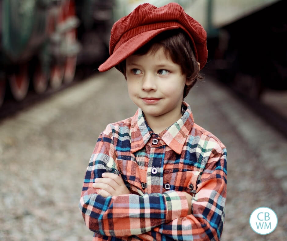 Boy looking to the side while wearing a cap on his head