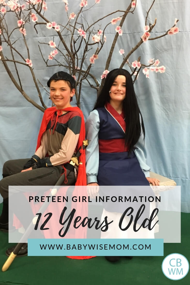 Girl and boy dressed as Shang and Mulan