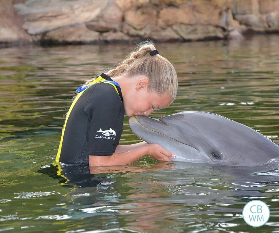 McKenna kissing a dolphin