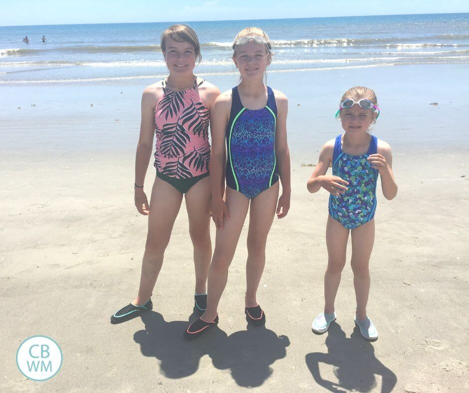 Three girls standing on the beach at Cocoa Beach, Florida