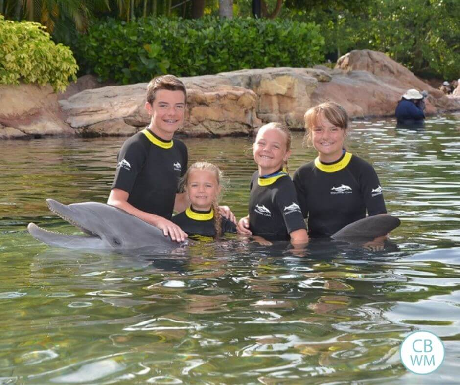 Children swimming with the dolphin Rosie at Discovery Cove