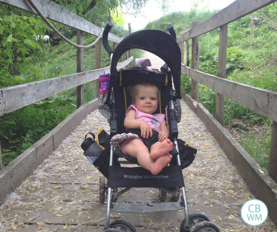 10 month old baby in a stroller on a bridge
