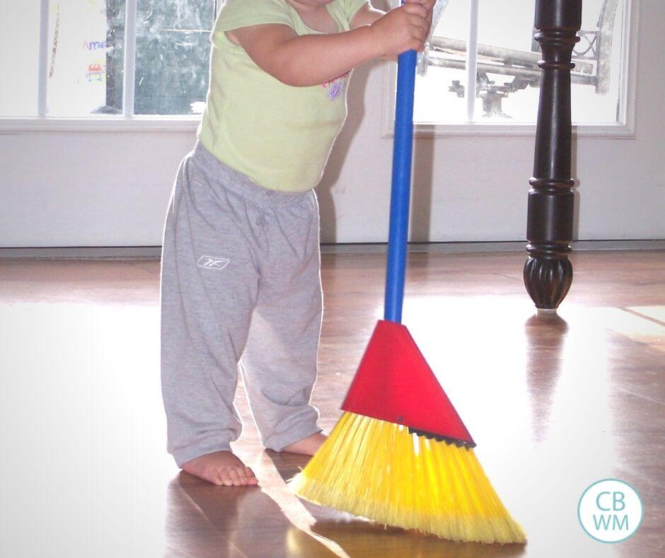 Toddler doing chores