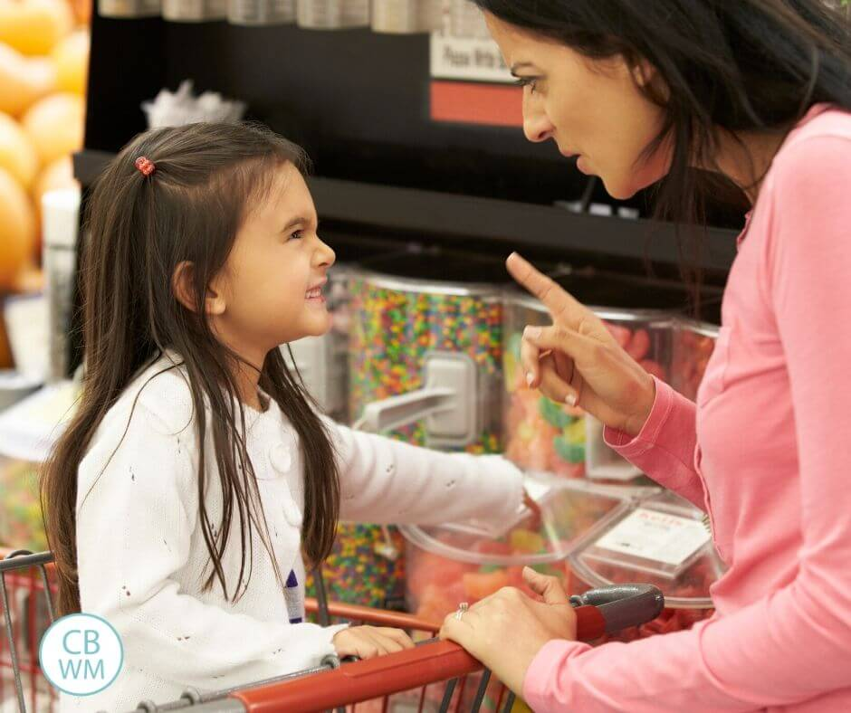 Mom scolding child at the store