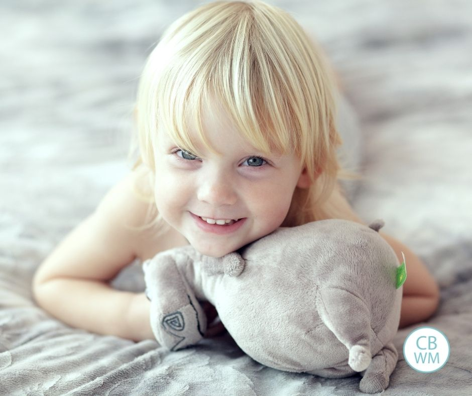 child smiling on bed